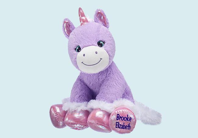 紫色坐姿微笑独角兽玩具
