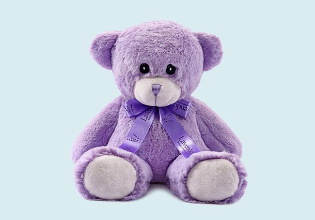紫色领结泰迪熊玩具